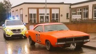 Car with police car