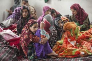 Villagers at a relief camp in a government-run school in Uri.