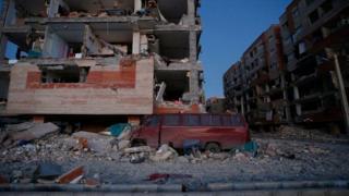 "A damaged van and buildings are seen following a 7.3-magnitude earthquake at Sarpol-e Zahab in Iran""s Kermanshah province on November 13, 2017"