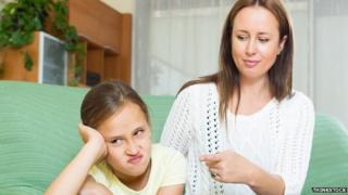 Mother berating daughter