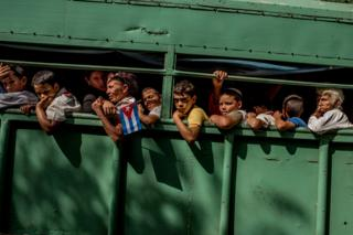 Trucks carry students home after the carriage carrying Fidel Castro's ashes passed in Las Tunas Province, Cuba on 2 December 2016.