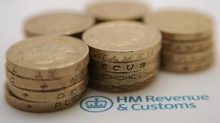Coins on HMRC leaflet