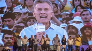 Photo released by Cambiemos press office of Mauricio Macri (on screen), celebrating at the Cambiemos party headquarters in Buenos Aires on 22 November, 2015,