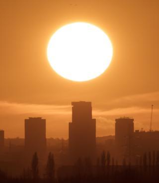 Sunset behind buildings
