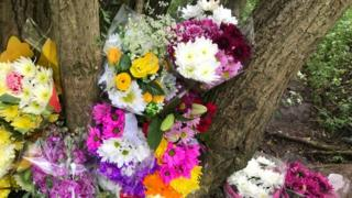 Floral tributes left at the scene