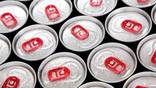 Tops of cans of energy drinks.