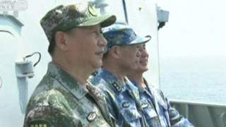 Chinese leader Xi Jiping inspects troops at a undisclosed location in the South China Sea