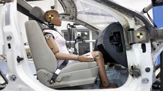 A crash-test dummy sits in a testing sled at Takata's current crash-testing facility August 19, 2010 in Auburn Hills, Michigan