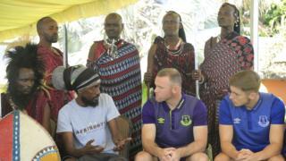 Wayne Rooney with Massai warriors