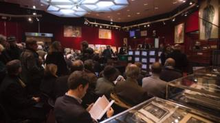 People attend an auction at Hotel Drouot in Paris (filed picture)