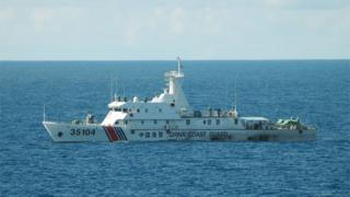 hand out picture released by the Japan Coast Guard on August 6, 2016 shows the China coast guard ship 35104 sailing near the waters of disputed East China Sea islands.