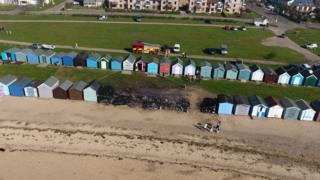 Burnt-out beach huts in West Mersea.