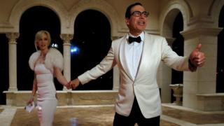 Steven Mnuchin and his wife Louise Linton arrive for a New Year's Eve party with U.S. President Donald Trump at his Mar-a-Lago club in Palm Beach, Florida, on 31 December 2017.