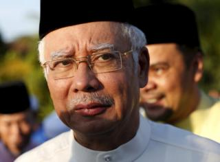 Malaysia's Prime Minister Najib Razak arrives for a news conference at a mosque outside Kuala Lumpur, Malaysia, in this 5 July 2015 file photo