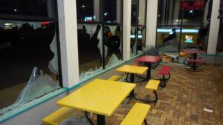 A fast food restaurant with smashed windows