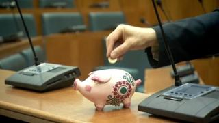 Piggy bank in a council chamber