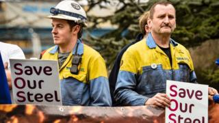 """Steel workers holding """"save our steel"""" placards"""