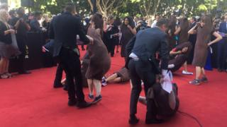 Women stage a 'sausage protest' on the red carpet