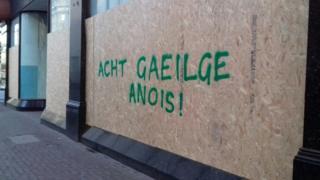 Graffiti in Belfast calling for an Irish language act,
