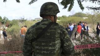 Mexican soldier guards the area where Gisele Mota was killed