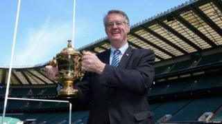 World Rugby Chairman Bernard Lapasset holds the Webb Ellis Cup during the Rugby World Cup 2015 Schedule Announcement held at Twickenham Stadium