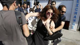 A participant is detained by Turkish police during the Istanbul LGBT Pride Parade