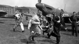 A squadron of Spitfires took part in mimic 'air alarms', during a speed demonstration at Duxford Aerodrome, 4th May 1939. Seen here are some of the pilots rushing to their planes before take off.
