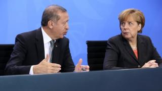 German Chancellor Angela Merkel (R) and Turkish Prime Minister Recep Tayyip Erdogan speak to the media following talks in Berlin on 4 February 2013.