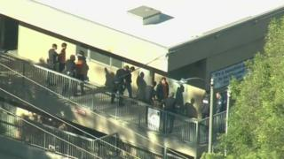 Police checked students as they were evacuated from classrooms