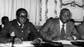 Roobart Mugaabee (lbitaa) and Joshuwaa Nikomo (mirga) Landan.