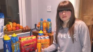 Photo of Yvette with bottles of Lucozade