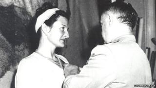 William Donovan, the creator of the OSS, pins a medal on Virginia Hall in a private ceremony in 1945
