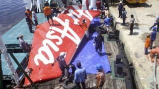A section of AirAsia flight QZ8501's tail is loaded onto a boat for transportation to Jakarta from Kumai Port, where it had been stored since it was recovered last month, near Pangkalan Bun, Central Kalimantan 7 February 2015 in this file photo taken by Antara Foto.