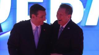 Ted Cruz and John Kasich laugh during a Republican debate.