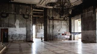 A child walks through the hall of the derelict palace of Mobutu Sese Seko in Gbadolite, DR Congo - Sunday 3 December 2017