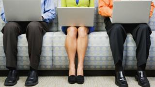 Men and a woman with laptops