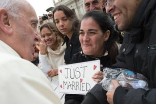 Pope Francis greets a newly married couple at the Vatican, 23 March
