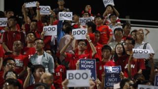 Hong Kong football fans boo China national anthem