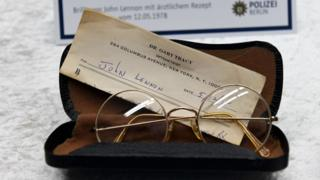 Glasses from the estate of John Lennon are pictured during a press conference on November 21, 2017 in Berlin.