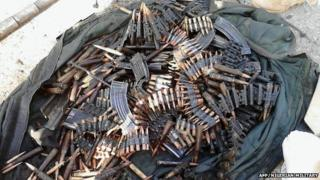 A handout picture released by the Nigerian military and taken on 23 May 2015 shows arms and ammunition recovered from Boko Haram Islamists during military operations in Dikwa