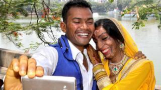 Lalita Ben Bansi in her wedding dress with groom Ravi Shankar