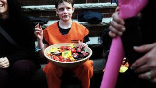 People trick-or-treat in a Brooklyn neighborhood on Halloween night on October 31, 2015 in New York City.