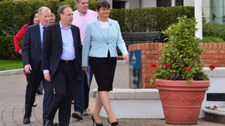 DUP members Emma Little-Pengelly, Sammy Wilson, Gregory Campbell, Gavin Robinson, Nigel Dodds and party leader Arlene Foster outside the Stormont hotel in Belfast.