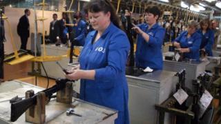 Workers assembling Kalashnikov rifles at the Izhmash weapons factory