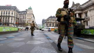 Soldiers stood guard on Tuesday in the normally busy Rue du Midi (24 Nov)