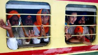 Sikh pilgrims board a train at Amritsar railway station