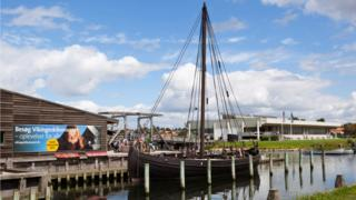 A view of a boat outside the Viking Ship Museum
