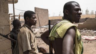 Vigilante people for Bakin Kogi, Kaduna state, northwest Nigeria dey look di damage after herdsmen attack di village on 24 February, 2017
