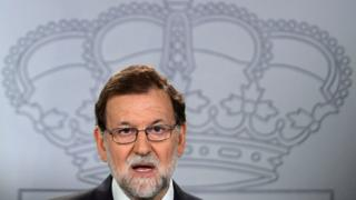 Spanish Prime Minister Mariano Rajoy attends a press conference at La Moncloa palace in Madrid