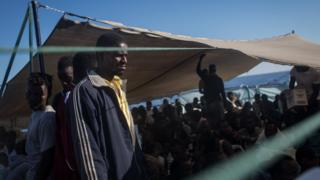 Migrants on board the Migrant Offshore Aid Station (MOAS) Phoenix vessel en route to Italy, 11 June 2017